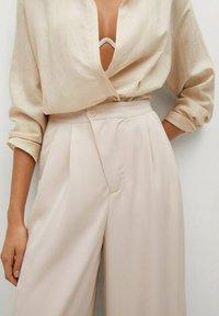 Mango - MOMA-A - Spodnie materiałowe - ecru - 4
