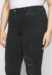 ONLY Carmakoma - CARRUSH LIFE REG SK ANK RAW - Jeans Skinny Fit - black denim - 4