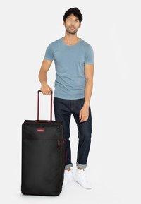 Eastpak - Wheeled suitcase - blakoutstripred - 1