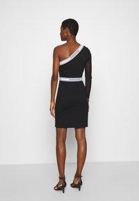 Calvin Klein Jeans - ASYMM MILANO LOGO FITTED DRESS - Shift dress - black - 2