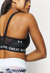 Under Armour - PROJECT ROCK BRA SOLID - Medium support sports bra - black - 4