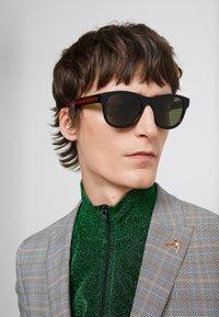 Gucci - Occhiali da sole - black/green - 1