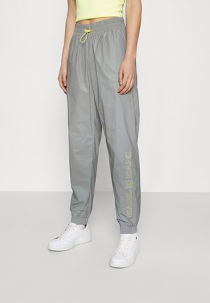 RETRO SHINY TRACKPANTS - Tracksuit bottoms - light grey