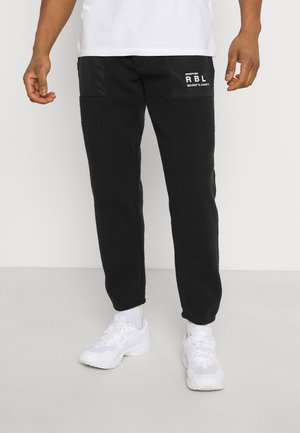 EDRIC PANTS - Verryttelyhousut - black