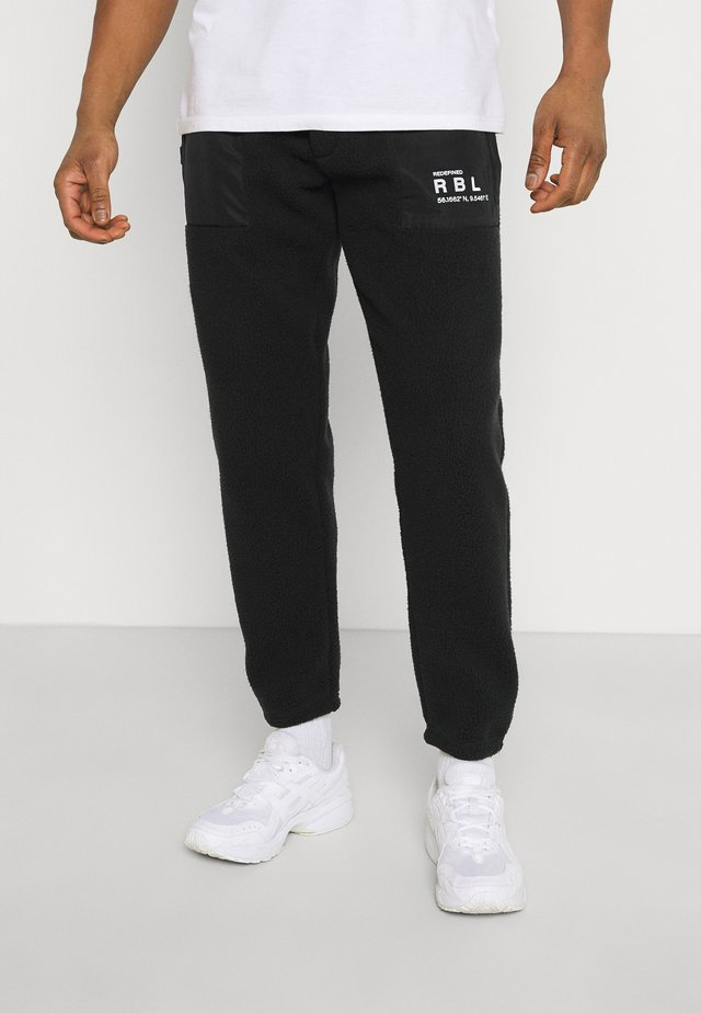 EDRIC PANTS - Trainingsbroek - black