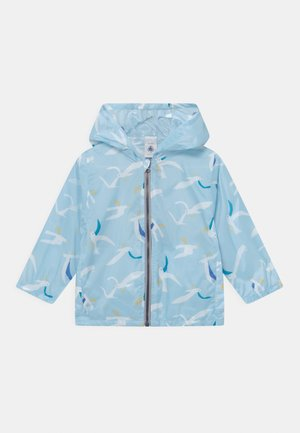 COUPE VENT - Waterproof jacket - blue