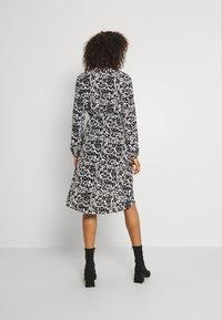 JDY - JDYROXANNE WRAP DRESS - Day dress - white/black - 3