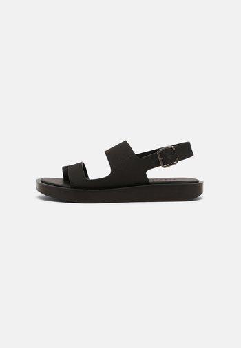ASHLEY - T-bar sandals - black