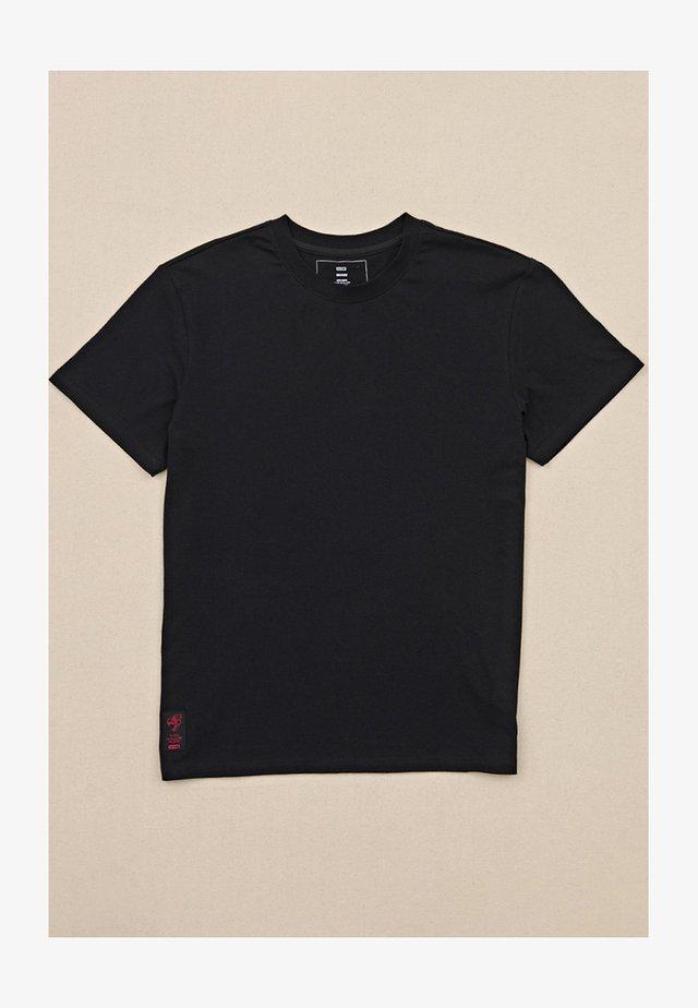 DION AGIUS - T-shirt imprimé - black