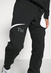 Nike Sportswear - PANT - Trainingsbroek - black/white - 2