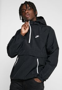 Nike Sportswear - Cortaviento - black/white - 0