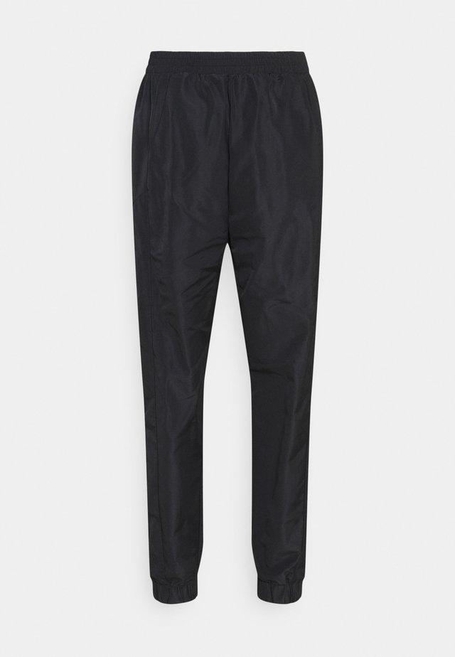 NMKAJA PANTS - Spodnie treningowe - black