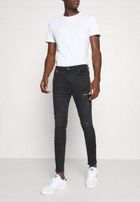 11 DEGREES - ABRASION SUPER SKINNY - Slim fit jeans - black - 0