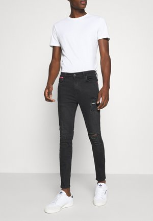 ABRASION SUPER SKINNY - Jeans slim fit - black
