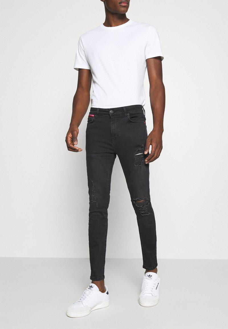 11 DEGREES - ABRASION SUPER SKINNY - Slim fit jeans - black