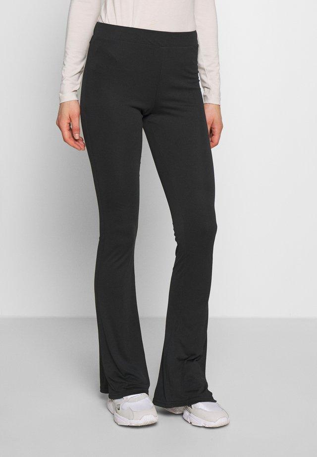 PCNUKITA FLARED PANTS - Leggings - black