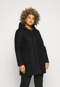 Vero Moda Curve - VMMOLLYHOODIE JACKET - Classic coat - black - 0