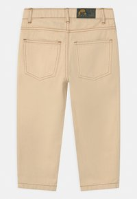 TINYCOTTONS - UNISEX - Relaxed fit jeans - light cream - 1