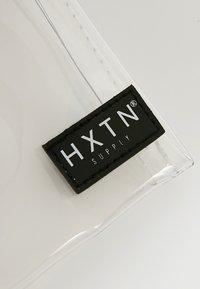 HXTN Supply - PRIME CROSSBODY UNISEX - Taška spříčným popruhem - optic clear - 4