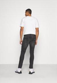 AllSaints - CIGARETTE - Jeans Skinny Fit - washed black - 2