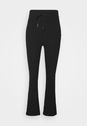 LIFESTYLE YOGA FLARE PANT - Tracksuit bottoms - black