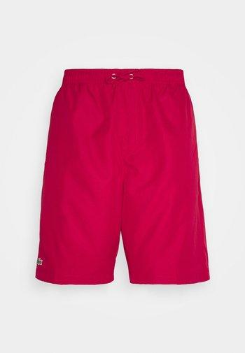 HERREN SHORT - Sports shorts - ruby