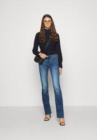 G-Star - 3301 MID BOOTLEG - Jeans bootcut - medium indigo - 1