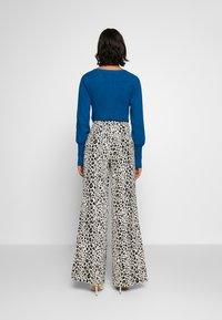 Fabienne Chapot - PUCK TROUSER - Trousers - black/offwhite - 2