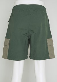 adidas Originals - UTILITY TWO IN ONE ORIGINALS - Cargo trousers - green oxide/clay - 8