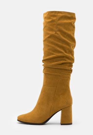 Stivali alti - mustard