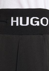 HUGO - HASISI - Tracksuit bottoms - black - 6