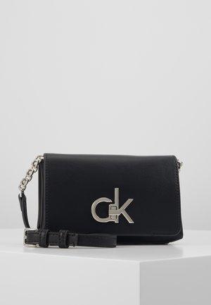 RE-LOCK FLAP CROSSBODY  - Across body bag - black