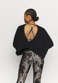 Onzie - Long sleeved top - black - 2
