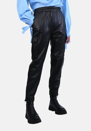 CARGO - Leather trousers - black