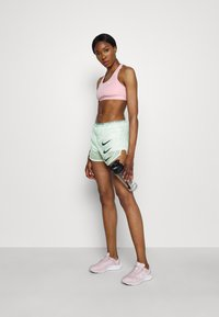 Nike Performance - RUN TEMPO LUXE  - Sports shorts - barely green - 1