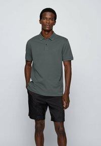 BOSS - KURZARM - Polo shirt - dark green - 0