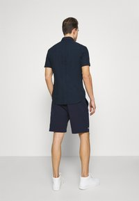 Lacoste - Tracksuit bottoms - navy blue - 2