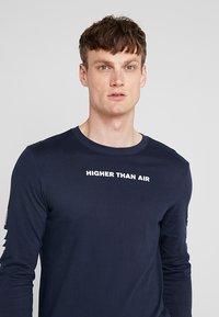 Nike Performance - DRY RUN SEASONAL  - Camiseta de deporte - obsidian/white - 3