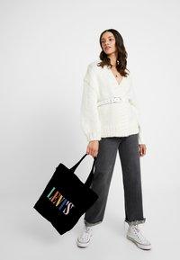 Levi's® - SERIF LEVI'S® MULTI - Bolso shopping - regular black - 1