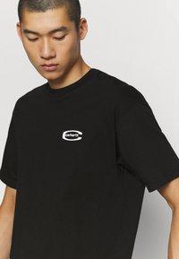 Carhartt WIP - MIRROR  - Print T-shirt - black - 3