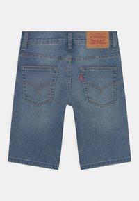 Levi's® - SLIM FIT ECO FLEX  - Denim shorts - dark blue denim - 1