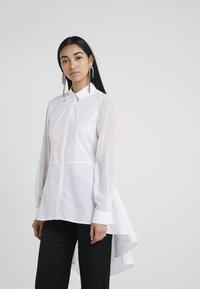 KARL LAGERFELD - POPLIN PEPLUM - Button-down blouse - white - 0
