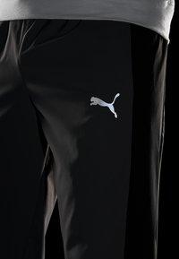 Puma - REACTIVE PACKABLE PANT - Outdoor trousers - castlerock black/white - 5