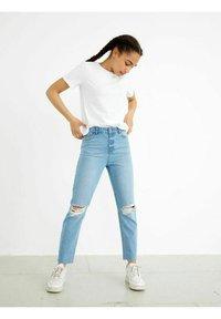 LMTD - HIGH WAIST - Slim fit jeans - light blue denim - 0