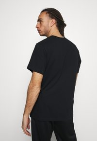 Nike Performance - DRY TEE  - Print T-shirt - black - 2
