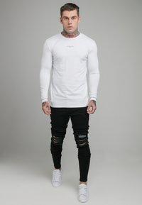 SIKSILK - RAW HEM BURST KNEE - Jeans Skinny Fit - black - 1