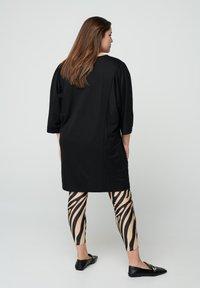 Zizzi - ZEBRA - Leggings - Trousers - beige - 1