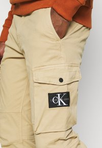 Calvin Klein Jeans - WASHED PANT - Cargo trousers - beige - 3