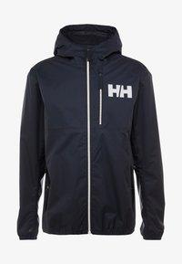 Helly Hansen - BELFAST PACKABLE JACKET - Waterproof jacket - navy - 4