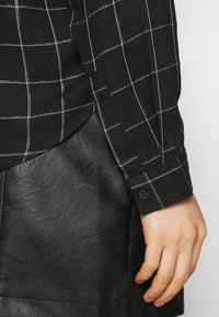 ONLY - ONLANNALIE - Button-down blouse - black/white - 5